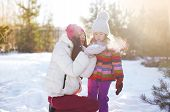 Mother And Child Having Fun In Sunny Winter Day