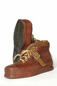 stock photo of ski boots  - Ski boots vintage sports equipment objects isolated - JPG