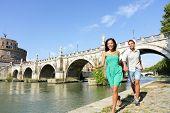 foto of castle  - Romantic couple tourists walking Castel Sant Angelo - JPG