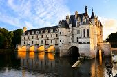 image of chateau  - Beautiful Chateau de Chenonceau at dusk over the River Cher Loire Valley France - JPG