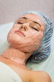 stock photo of facials  - Beautiful woman with facial mask at beauty salon - JPG