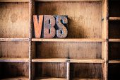 picture of typing  - The word VBS written in vintage wooden letterpress type in a wooden type drawer - JPG