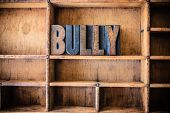 picture of bullying  - The word BULLY written in vintage wooden letterpress type in a wooden type drawer - JPG