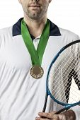 stock photo of gold medal  - Tennis player celebrating with a gold medal on a white background - JPG