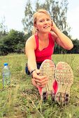 image of stretching exercises  - Happy Smiling Young Woman Runner Exercising and Stretching Fitness in Summer Nature Outdoors Healthy Lifestyle Activity Motivation and Inspiration Outside - JPG