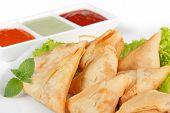 image of samosa  - homemade fried samosas and sauces on white background - JPG