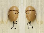 picture of human egg  - two happy friend with painted egg on wood - JPG
