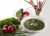 stock photo of sorrel  - Vegetarian soup with sorrel on a white table and tulips in a vase - JPG