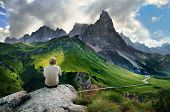 stock photo of ferrite  - The young man is resting on the rock after hiking trip - JPG