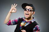 stock photo of karaoke  - Funny man singing in karaoke - JPG