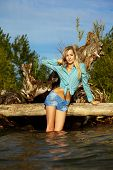 Blonde Posing Near Flotsam