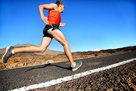 stock photo of cardio exercise  - Runner man running sprinting for success on run - JPG