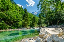 picture of mountain-high  - Beautiful alpine landscape with a mountain brook on the background of the high peaks of the mountains - JPG