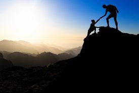 picture of landscapes beautiful  - Teamwork couple hiking help each other trust assistance silhouette in mountains sunset - JPG
