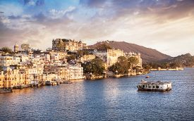 picture of cloudy  - Lake Pichola with City Palace view at cloudy sunset sky in Udaipur Rajasthan India - JPG
