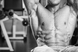image of abdominal  - A man pumping abdominal muscles in the gym - JPG