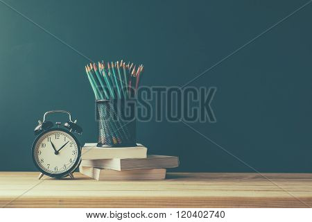 Books and blackboard school supplies back to school