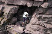 Female Climber ascending the 'Old Man of Stoer'