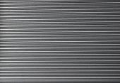 Galvanized Steel Roller Shutter Door, suitable for use as industrial background.