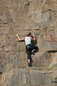 Female climber on cliff face
