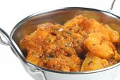 'Bombay aloo' curry with potatoes, tomatoes and fresh coriander