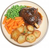 Roast lamb shank with sauteed potatoes and vegetables