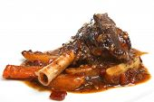 Lamb shank with roasted parsnips and carrots.
