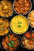 Variety of Indian curries and rice.