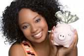 picture of holding money  - Woman Holding Piggy Bank - JPG