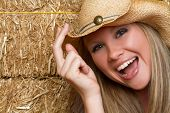 Laughing Cowgirl in Hay