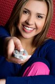 Girl Holding TV Remote