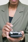 Midsection of businesswoman with palm pilot