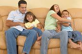 picture of tickling  - Family tickling each other on the sofa - JPG