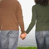 stock photo of holding hands  - Close up of couple holding hands - JPG