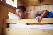 Man laying in wooden bunk