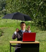 businessman with umbrella, hiding from the sun