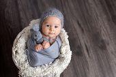 Christmas Portrait Of Cute Little Newborn Baby Boy, Wearing Santa Hat poster