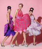 Three beautiful girls in pin up style dress