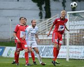 KAPOSVAR, HUNGARY - MAY 14: Robert Zsolnai (R) in action at a Hungarian National Championship soccer game - Kaposvar vs Szolnok on May 14, 2011 in Kaposvar, Hungary.