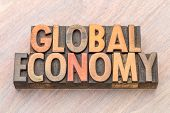 global economy word abstract in vintage letterpress wood type poster