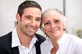 stock photo of adoration  - Adult son and his aging mother - JPG