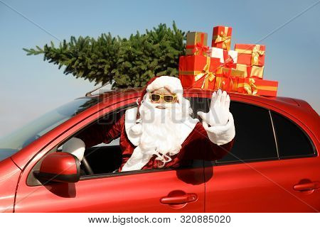 poster of Authentic Santa Claus With Presents And Fir Tree On Roof Driving Modern Car Outdoors