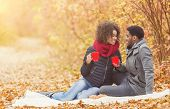 Young Couple Enjoying Picnic In Autumn Park, Drinking Coffee And Enjoying Time, Free Space poster
