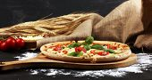 Vegetarian Italian Pizza With Tomatoes, Mozzarella Cheese  And Basil. Delicious Italian Pizza poster