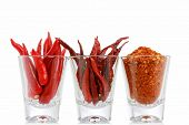 Three versions of Red Pepper : Fresh Chili, Dried Chili and Chili Powder in a glass, isolated on whi