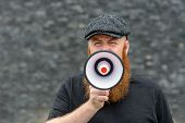 Bearded Man Speaking Into A Megaphone poster