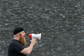 Man With A Grievance Yelling Into A Megaphone poster