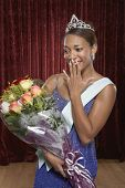 Beauty queen holding a bouquet of roses