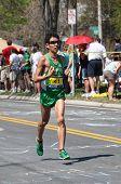 Tamura Hideaki (Japan) races up Heartbreak Hill during the Boston Marathon