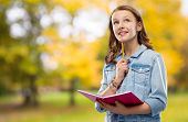 education, school, inspiration and people concept - teenage student girl in denim jacket with diary  poster